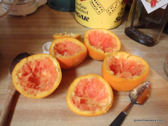 Hollowing out the oranges for Frozen Orange Kiss Desserts. They are the perfect way to end a special meal! Lovely and refreshing. Naturally gluten free, but loved by all. Use store-bought orange sherbet if you prefer. [from GlutenFreeEasily.com]
