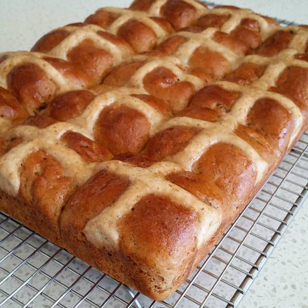 """Do you prefer the crosses on your Hot Cross Buns to be iced on or baked in? I think these Gluten-Free Traditional Hot Cross Buns with the baked-in crosses are absolutely gorgeous! Plus, Kylie """"brushes over a sugar-spiced glaze, which adds another depth of flavour and deliciousness""""!"""