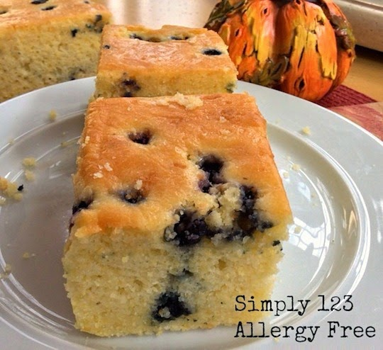 Gluten-Free Breakfast Blueberry Cornbread recipe. Also dairy free and mouthwatering! Both your family and your guests will love this treat for breakfast. [featured on GlutenFreeEasily.com] (photo)
