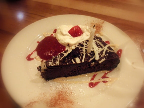 Flourless Chocolate Cake with Homemade Whipped Cream and Raspberry Coulis