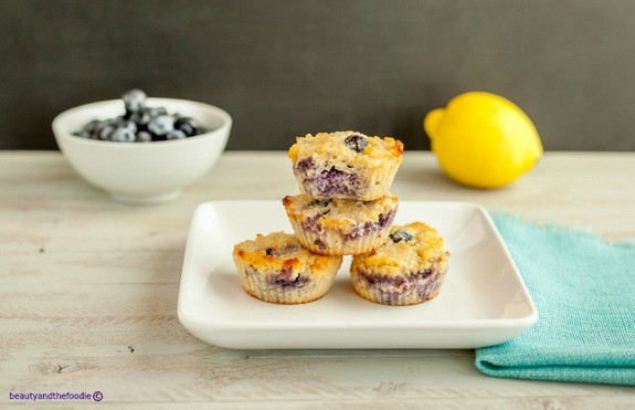Gluten free and grain free with low carb option. Glazed Lemon Berry Muffins from Beauty and The Foodie. March Muffin Madness!