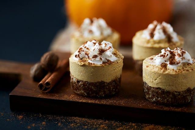 Grain-Free Mini Pumpkin Cashew Cheesecakes. Vegan, too. One of 30 gluten-free cheesecake recipes featured on gfe. [GlutenFreeEasily.com]