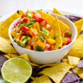 Strawberry Mango Summer Salsa. You won't be able to stop eating this salsa once you start! Lots of fruitiness, plus avocado, heat, and cilantro. Featured on GlutenFreeEasily.com.