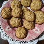 Flourless Gluten-Free Oatmeal Coconut Cookies on red and white plate on doily from above.