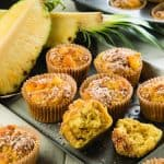 Gluten-Free Tropical Pineapple Ginger Muffins. These pineapple muffins have the power to transport you to a tropical island where coconuts abound and ginger is the spice of life. The streusel helps caramelize the pineapple so that you get all that gooey goodness. One of 20 gluten-free muffin recipes featured on gfe for March Muffin Madness.