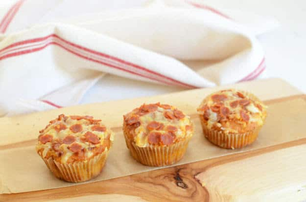 Low-Carb Pizza Muffins recipe. This easy muffin recipe is made with 8 ingredients total. All you need to throw it together is almond flour, eggs, tomato sauce, Parmesan, cheddar, pepperoni, salt, and baking soda. One of 20 gluten-free muffin recipes featured on gfe for March Muffin Madness.