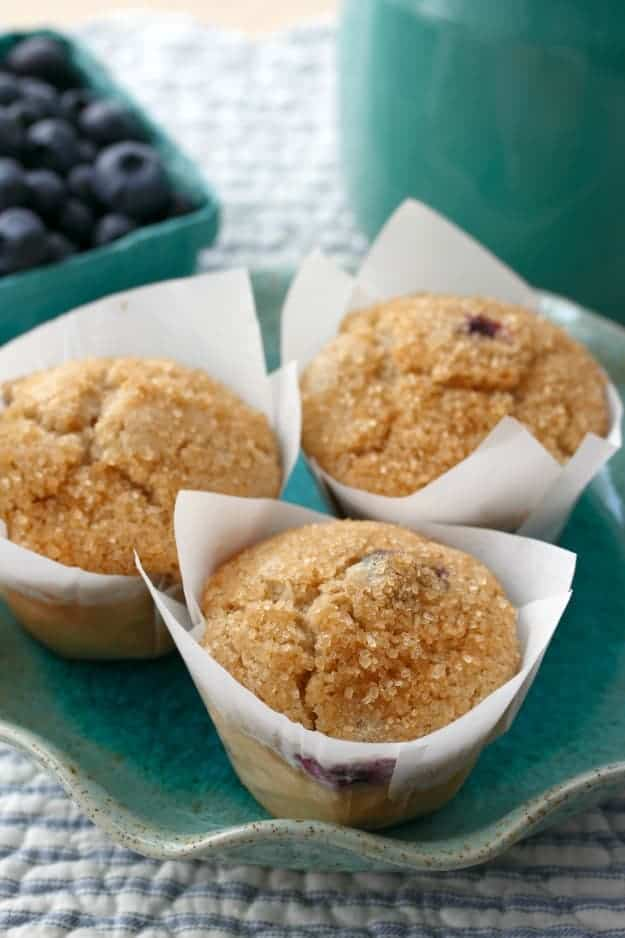 """Gluten-Free Blueberry Muffins with Sugar Crunch Topping. These muffins are fabulous when blueberries are in season but also work quite well with frozen blueberries. The raw sugar is what gives these muffins a crunchy top."""" One of 20 gluten-free muffin recipes featured on gfe for March Muffin Madness."""