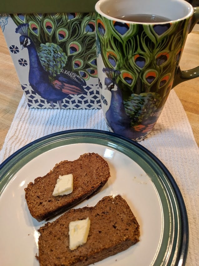 Gluten-Free Keto Pumpkin Bread. Two slices with my new peacock mug, a gift from a dear friend. Recipe from Keto Breads cookbook by Cassidy Stauffer. [featured on GlutenFreeEasily.com]