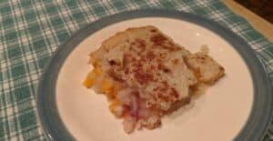 Gluten-Free Peach Cobbler serving on plate.