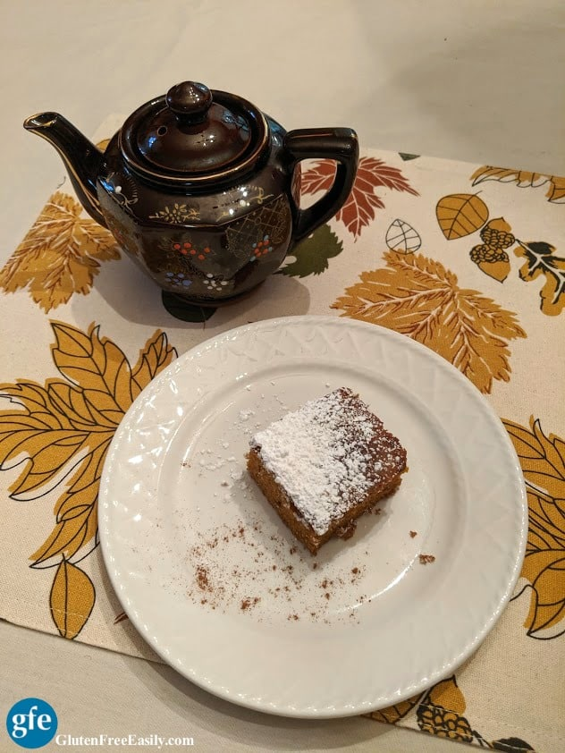 Slice of Pumpkin Spice Cider Cake with Teapot on Gluten Free Easily
