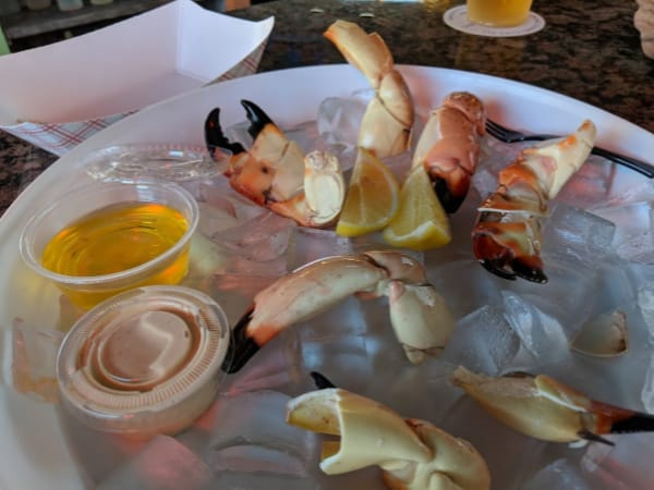 Melted butter and special sauce for dipping stone crab claws come with cracked stone crab claws.