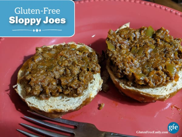Quick and Easy Gluten-Free Sloppy Joes on an onion Odd Bagel on a salmon plate with fork.