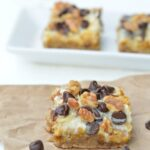 Gluten-Free 7-Layer Bars (Magic Cookie Bars). Pumpkin 7-Layer Bars shown, but also check out Gingerbread, Peppermint, and Valentine's versions also [featured on GlutenFreeEasily.com] (photo)